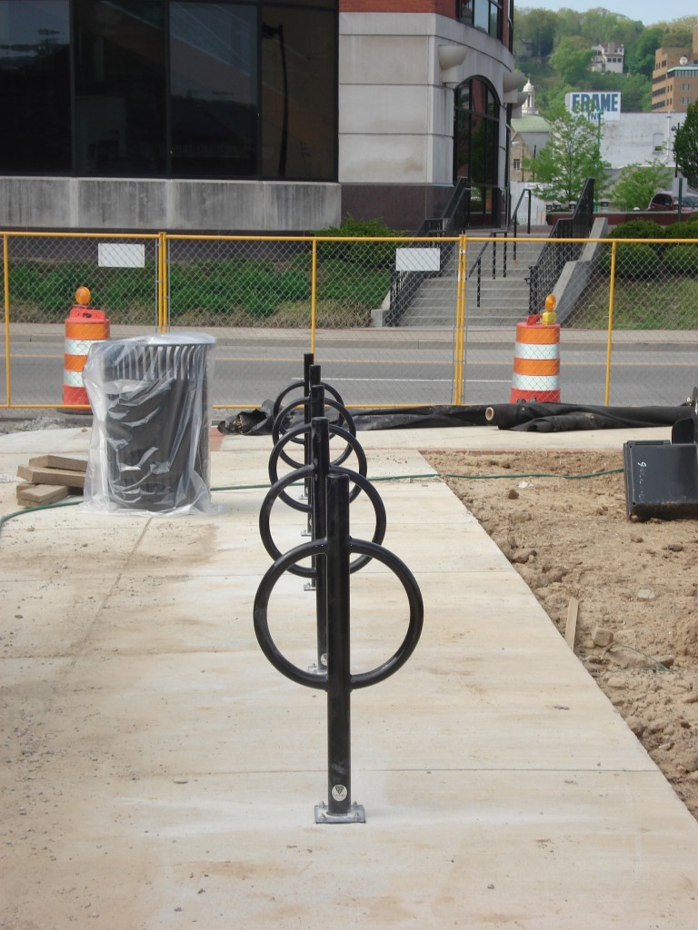 Bikes racks are installed along the eastern edge of the greenspace.